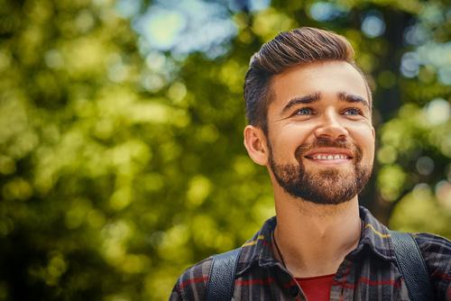 Portrait of bearded traveler male.